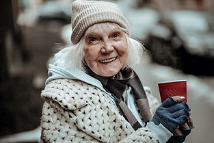 Homeless-lady-enjoying-a-warm-beveregae.