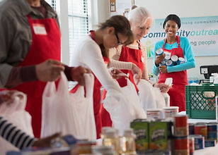 People volunteering at a Food Bank