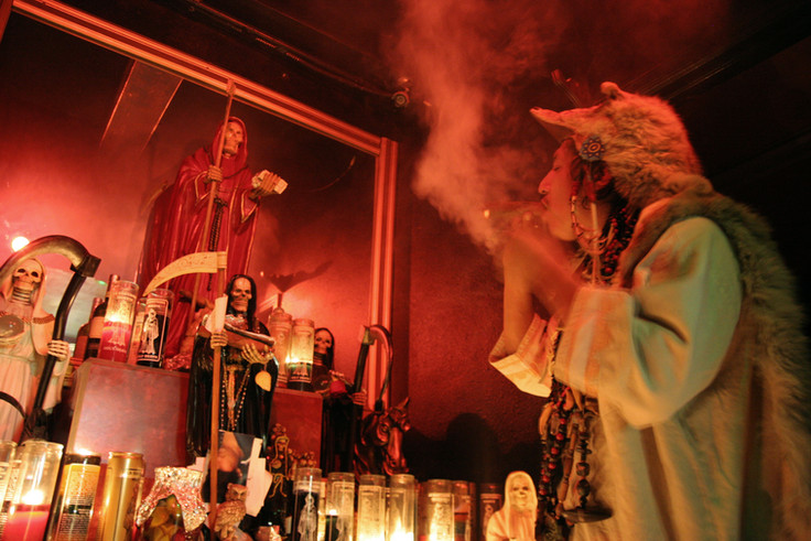 The Grand Shaman prays to La Santisima in the small shrine in a backroom of his temple. Tobacco has a long history of traditional use in indigenous rituals, where it is believed that the exhaled smoke carries one's thoughts and prayers to the intended recipient. The Shaman wears a coyote pelt given to him by his grandfather during all services and rituals.