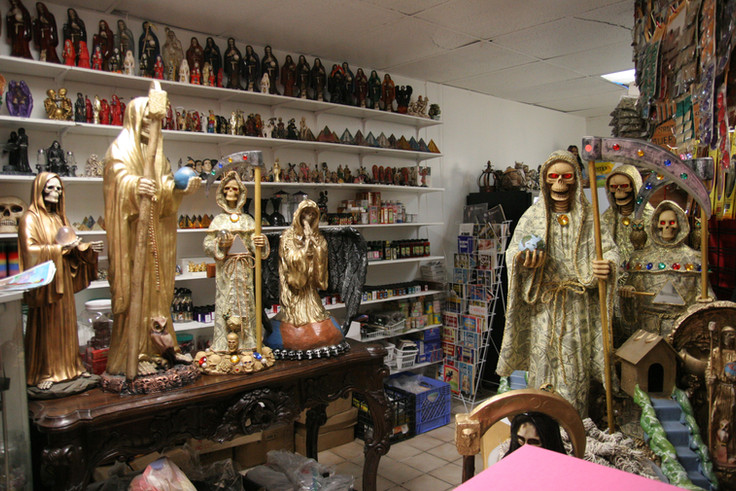 In addition to the Temple's worship space, there is also a small shop adjacent where effigies of La Santisima may be purchased. As with many religious icons, followers believe that the objects are imbued with the spirit of the Saint.