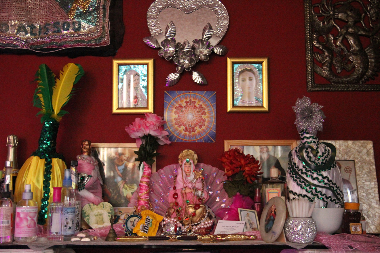 The permanent alter in the apartment indicates that one of the residents serves Erzulie Freda, the Loa of love, luxury and beauty. Her personality is embodied in the pink sparkles covering her alter.