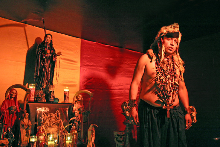 In addition to conducting Misas at the temple, the Shaman also offers various private ceremonies and religious services in a room above. For a limpieza, or ritual cleansing he first places a necklace with an image of Santa Muerte around their neck (and the photographer) to protect them from negative energy released during the rite.