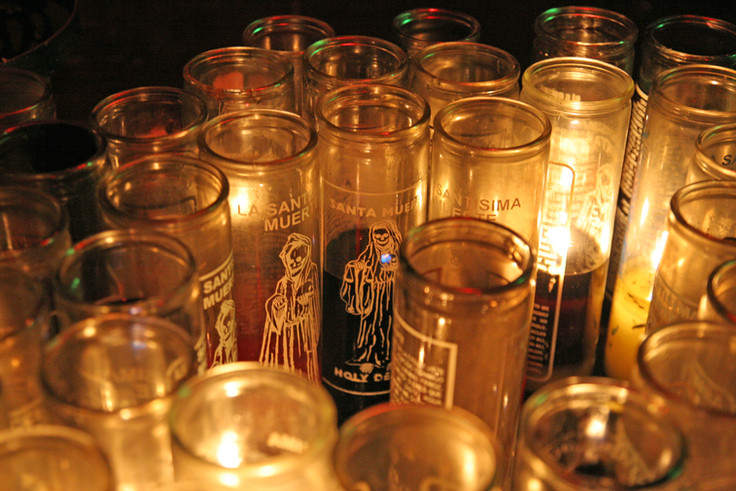Candles flicker at the alter from various petitions to La Santisima.