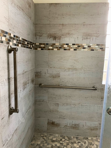 Grab bars in a roll-in shower. Handicap accessible!