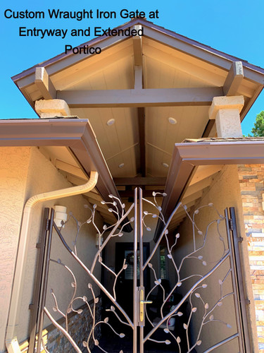 Custom Wraught Iron Gate at Entryway and Extended Portico