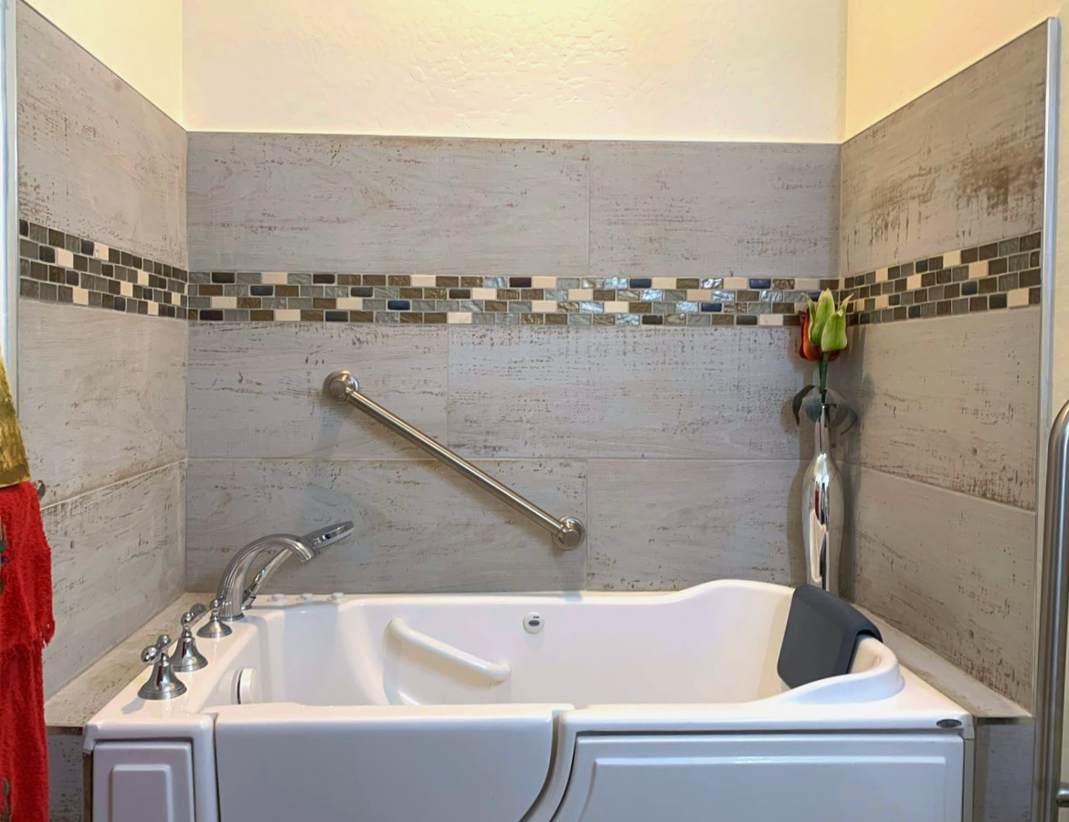 Multiple grab bars at shower wall, side of tub