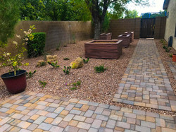 Pavers, New Rock, Planters, and Vegetation