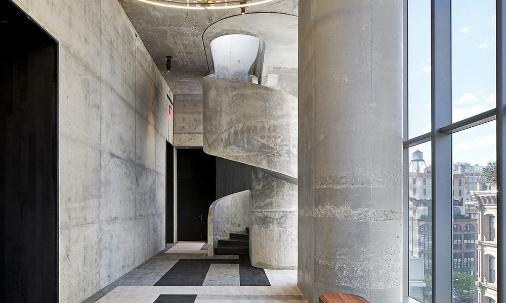 A hand-poured concrete staircase at 56 Leonard Street in TriBeCa.