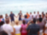 Baptism in the ocean with Dr. Manny Fernandez