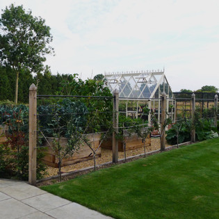 Farmhouse Garden with Victorian Style Greenhouse