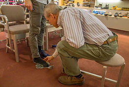Customer's foot being measured