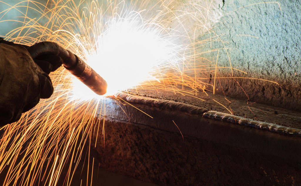 bigstock-Welding-Steel-Structure-In-Wor-54250016.jpg