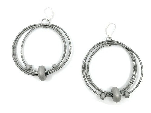 big wire loop with silver hematite disc earring