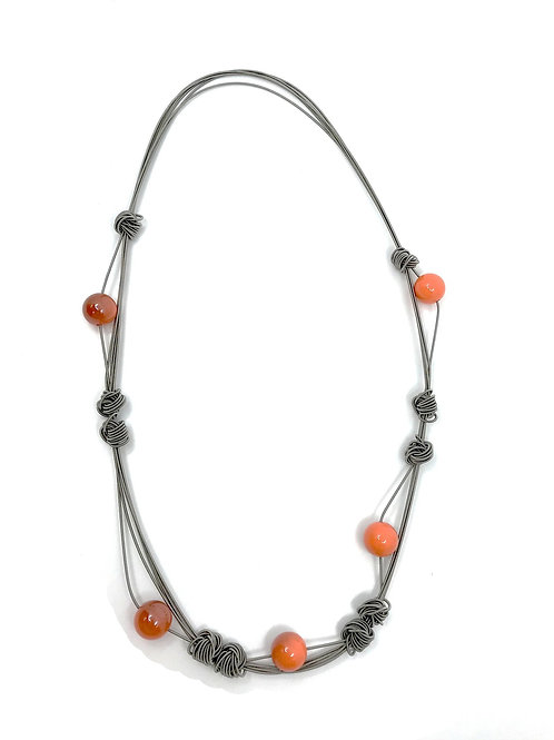 long wire with large knots and orange beads necklace
