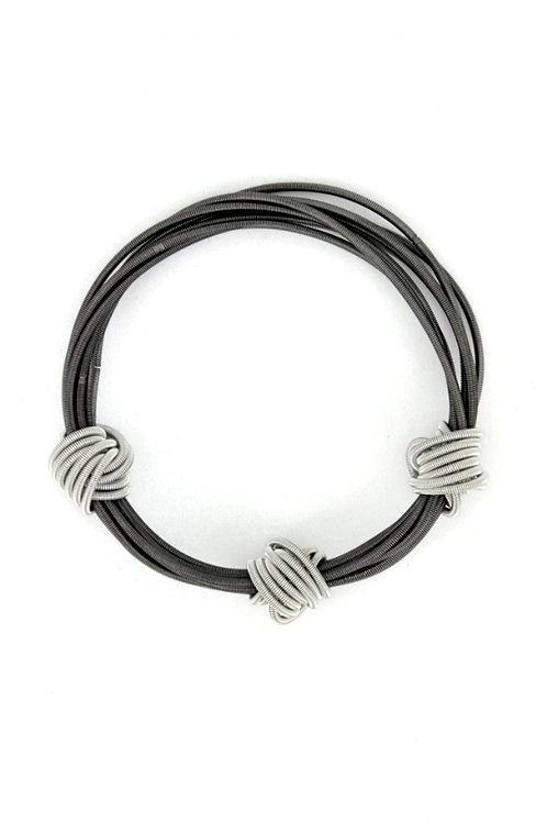 slate piano wire bracelet with three silver knots