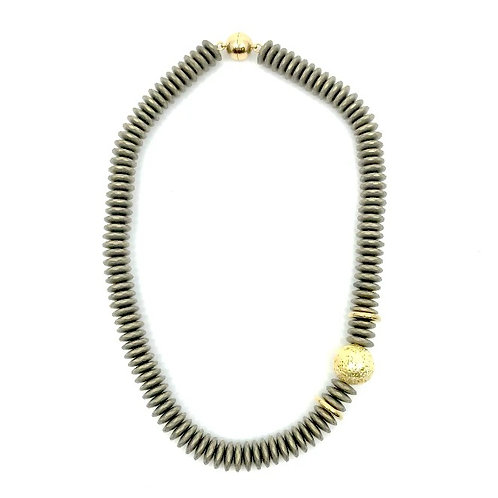 Matte gold short necklace with gold lava rock
