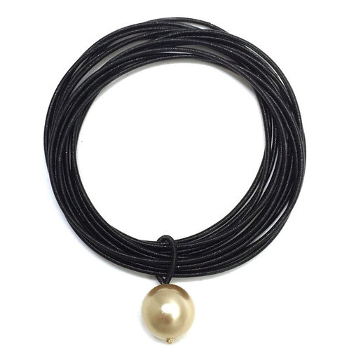 black piano wire bracelet with single gold pearl