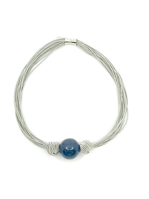 silver multi strand short necklace with large blue bead