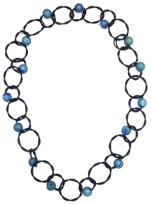 black multi loop piano wire necklace with blue geo