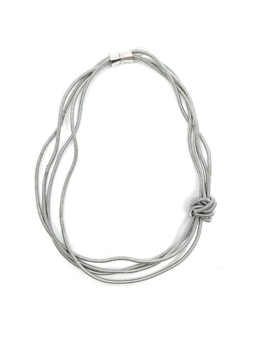 silver short wave piano wire necklace with large knot