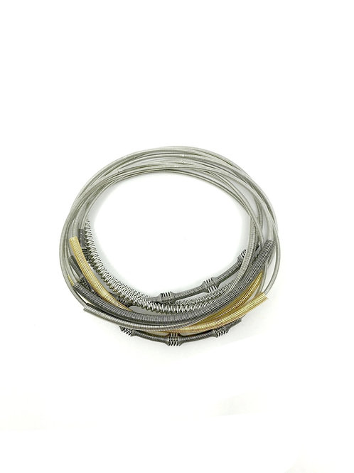 multi unbound bracelet with textured sleeves