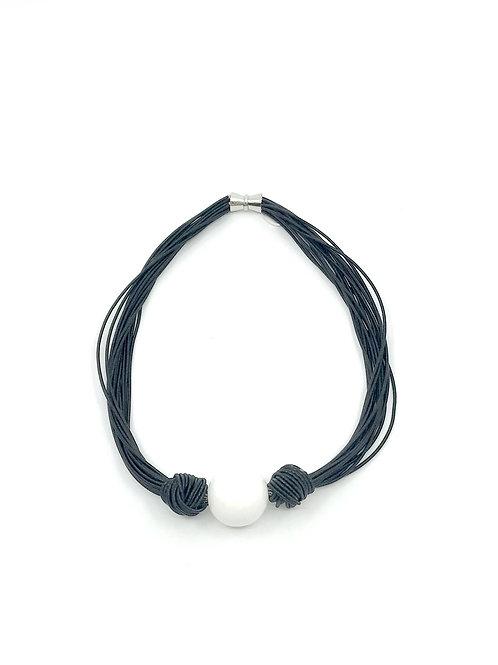 black multi strand short necklace with large white bead
