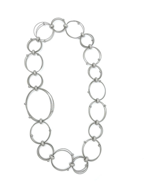 long looped wire necklace with large and small silver hematite discs