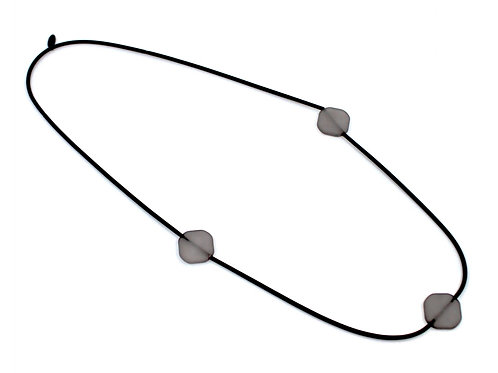 long black spring wire w/gray rubber beads necklace