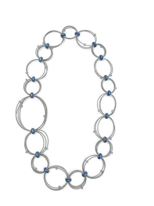 long looped wire necklace with large and small blue hematite discs