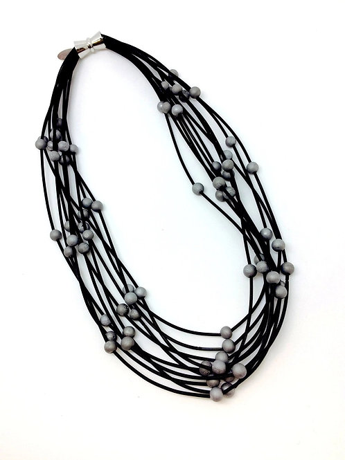 10 layer black necklace with silver geo