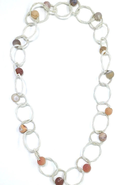 white multi loop piano wire necklace with apricot geo