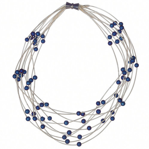 10 layer white necklace with blue geo