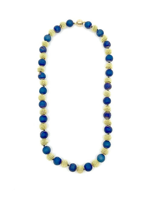 short blue geode necklace with gold coil
