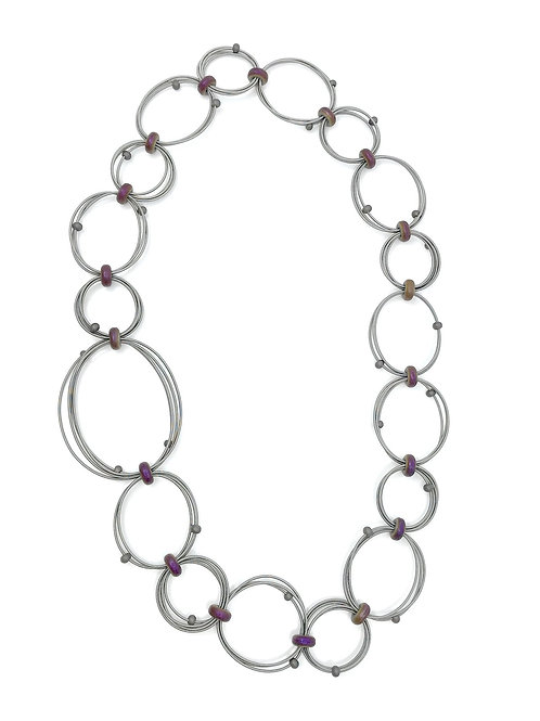 long looped wire necklace with large and small irri hematite discs