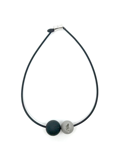 grey geode and black rubber ball necklace on short black wire