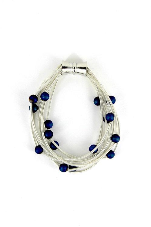 10 layer white bracelet with blue geo