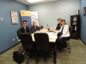 University of Alberta students sitting around a board room table