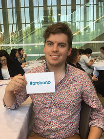 """A TRU student holding up a sign that says """"#probono"""""""