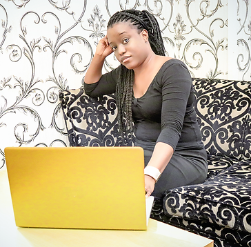 african-lady-with-braids-computer-yellow