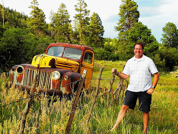 The author with one of his treasured rusty relics near the Vallecito Reservoir east of Durango, CO.