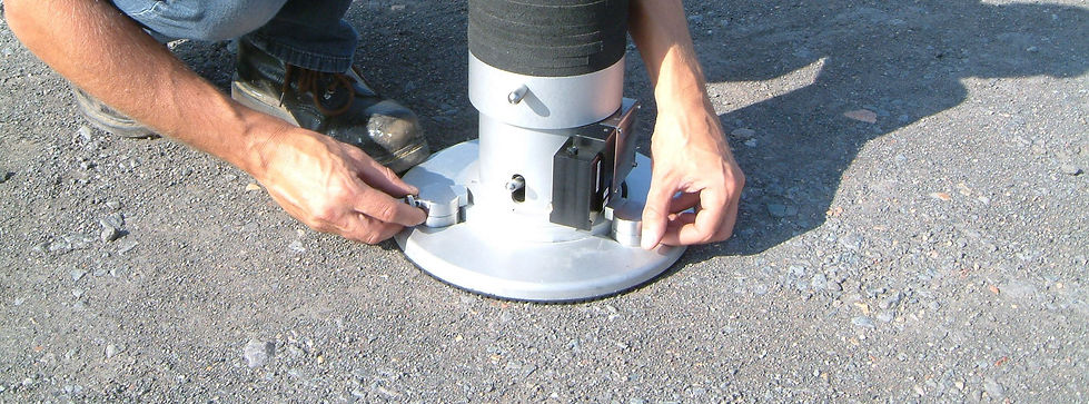 Engineer using light weight deflectometer in the field