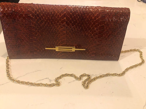 Italian snakeskin clinch handbag