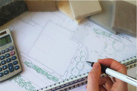 Garden designer at FORK, sketching out a design plan