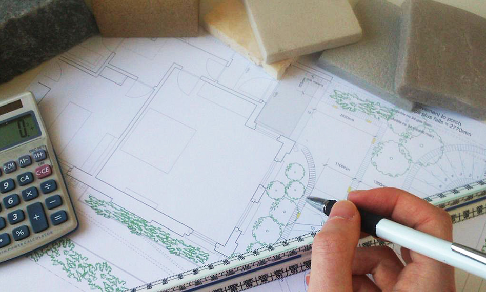 Garden designer drawing plans with samples