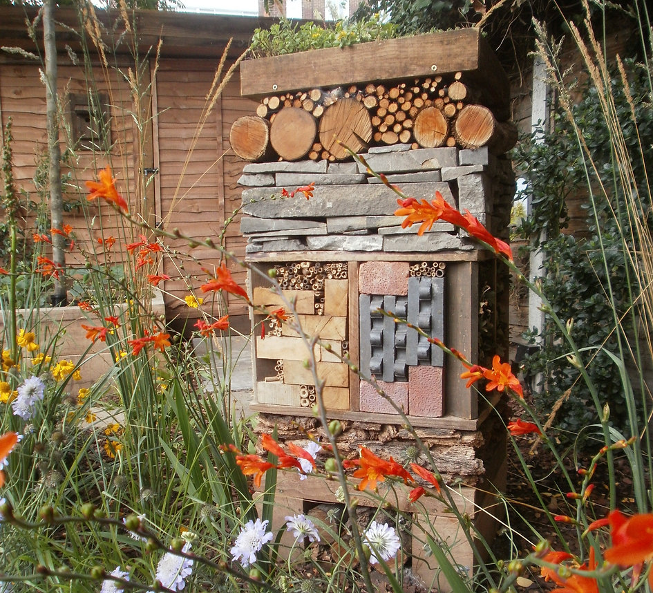 Fantastic wildlife hotel made from reused landscaping materials such as stone, bricks, timber, bark and logs.