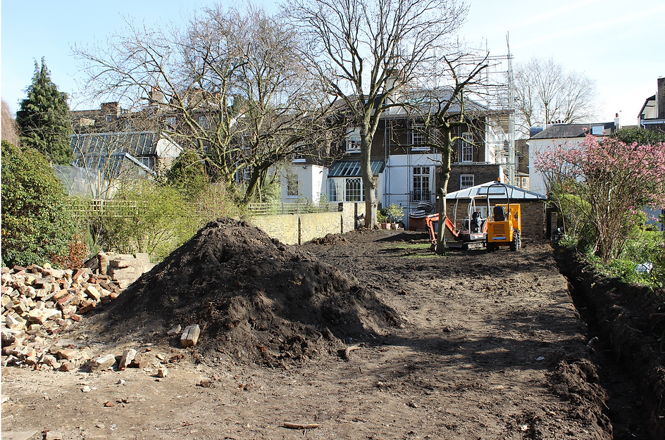 Large pile of soil in a large garden being landscaped