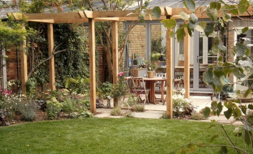 Oak pergola and lawn in a tradional style garden