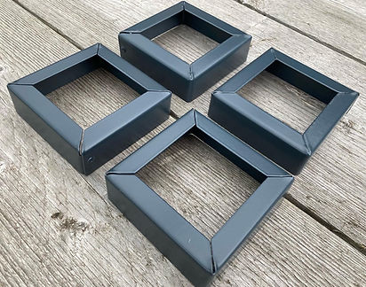 A set of 4 powder-coated grey planter feet, made by metal planters uk.JPG