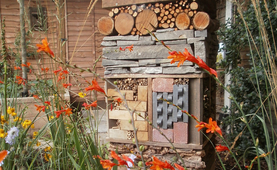 Wildlife tower with bug hotel and recycled materials