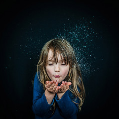 Girl Blowing Magic Dust
